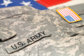 USA army uniform over US flag - studio shot