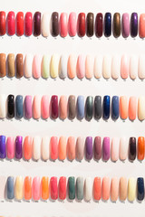 colorful nails on shelves in cosmetics shop