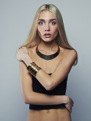 beautiful thin model. young blonde woman. girl in jewelry