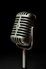 Vintage microphone on a black background