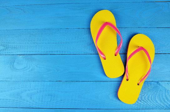 Flip Flops Yellow on blue wooden background