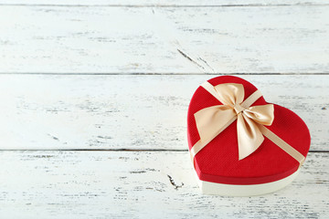 Beautiful heart gift boxes on white wooden background