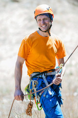 Smiling climber insures rope