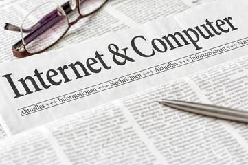 Zeitung mit der Überschrift Internet und Computer