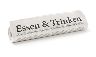 Zeitungsrolle mit der Überschrift Essen und Trinken