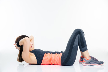 Fitness woman working out on the floor