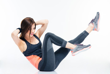 Smiling fitness woman doing abdominal exercises