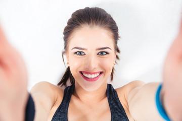 Smiling cute woman making selfie photo