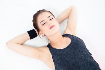 Sporty woman sleeping on the floor
