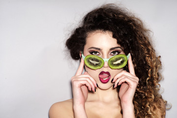 Fashionable young sexy girl in fruit glasses