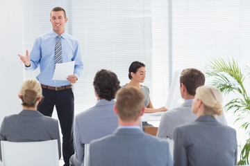 Smiling businessman talking during conference