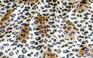 Crumpled leopard texture background