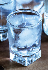 Сold fresh water with ice in a heart shape in the misted glasse