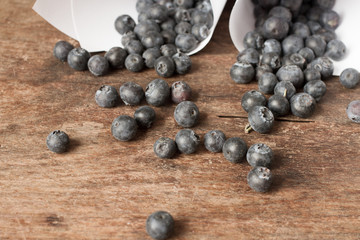 Blueberries in white paper bags