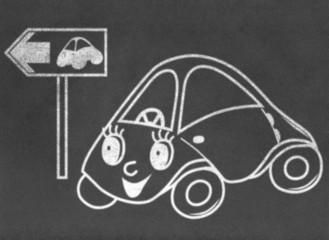 Toy car on green way on chalkboard