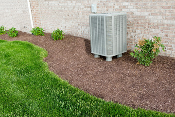 Air conditioner condenser heat pump unit standing outdoors