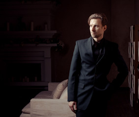 Fashion Man in luxury modern interior