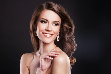 beautiful brunette girl with luxury accessories. fashion model