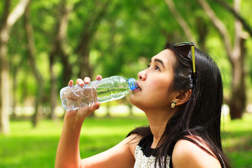 Stock Photo - Girl is Drinking water at park