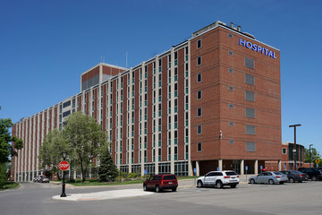large brick building with hospital sign Wall mural