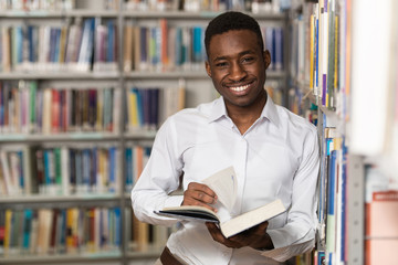 Handsome Young College Student In A Library