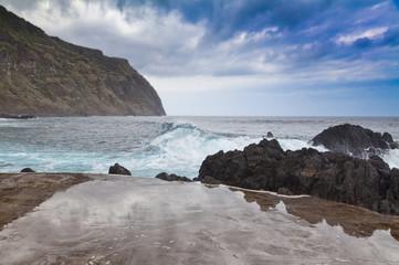 Fototapeten Rosa hell Rocky shore and natural pool. Porto Moniz, Madeira island, Portugal