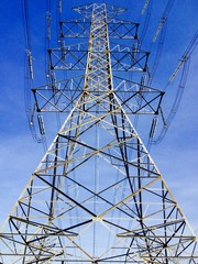 High voltage electricity pylon blue background