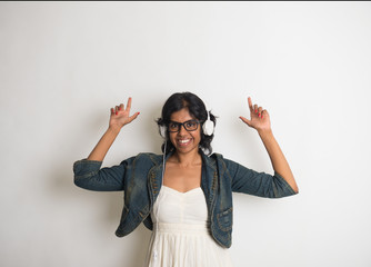 Indian girl dances while listening to her music
