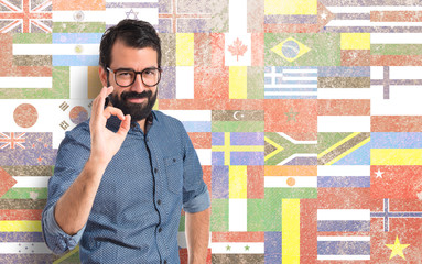 Young hipster man making Ok sign