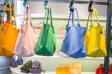 female bags in shop display window