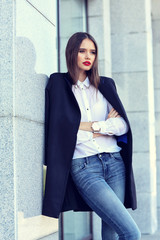 high fashion portrait of young elegant woman outdoor