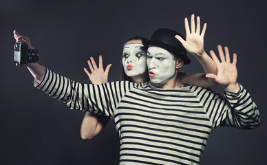 Funny couple of mimes taking a selfie photo