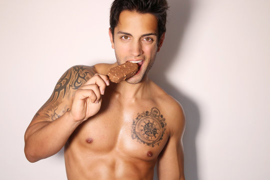 sexy male eating ice cream