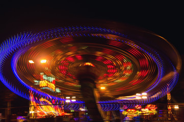 Evening lights rotating swing. Abstract