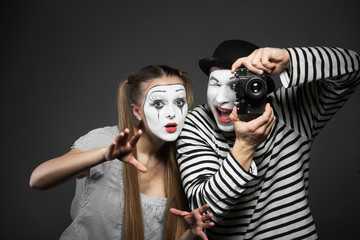 Funny couple of mimes taking a photo
