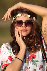 Sexy girl hippie in sunglasses looking at the camera
