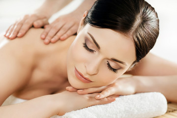 Young and beautiful woman on a massage therapy