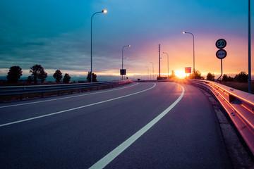 Strada e guard rail al tramonto Fototapete