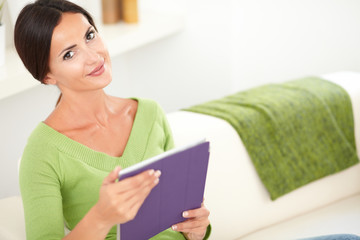 Peaceful young woman holding a tablet
