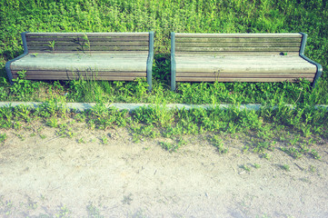 Wooden bench in park with vintage color.
