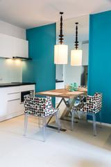 Modern small kitchen interior. / Contemporary mini kitchen with table sets.