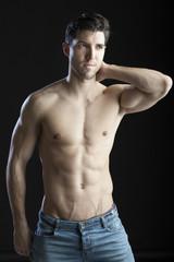 muscular man on black bacground
