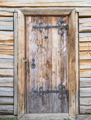 A door in a wooden wall.