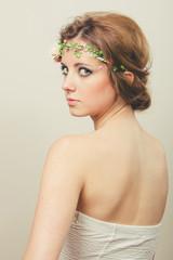 Beautiful woman with bun and tiara