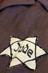 yellow star of David on his coat