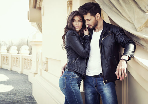 Sexy couple in leather jacket hugging each other