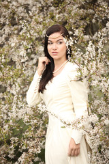 bride wedding dress in forest vintage white tree