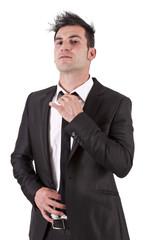 Man tying his tie suit