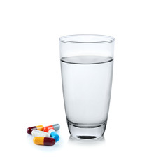 glass of water with pill capsule