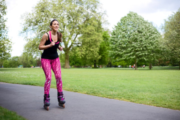 young woman skating in the park